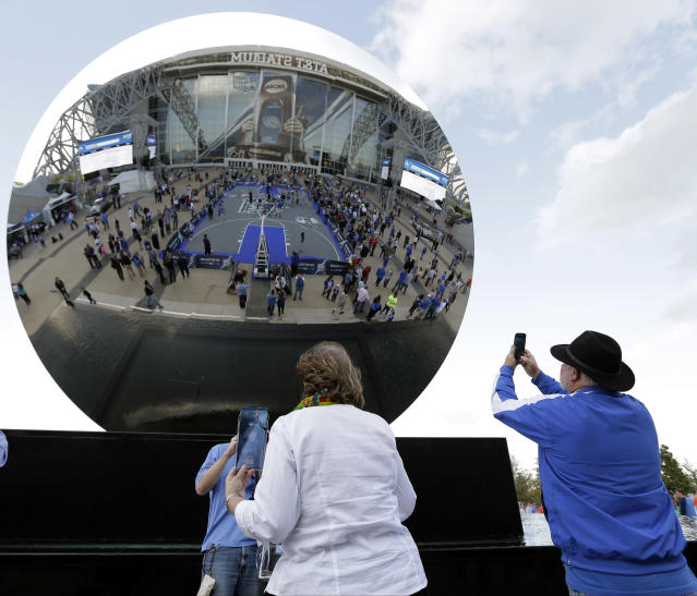 Fans make pictures outside AT&T Stadium before the NCAA Final Four tournament college basketball championship game between Connecticut and Kentucky Monday, April 7, 2014, in Arlington, Texas. (AP Photo/Eric Gay)