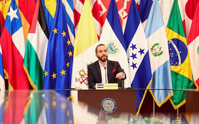 El Salvadoran President Nayib Bukele talks during a meeting with ambassadors accredited in his country at the National Palace in San Salvador - AFP
