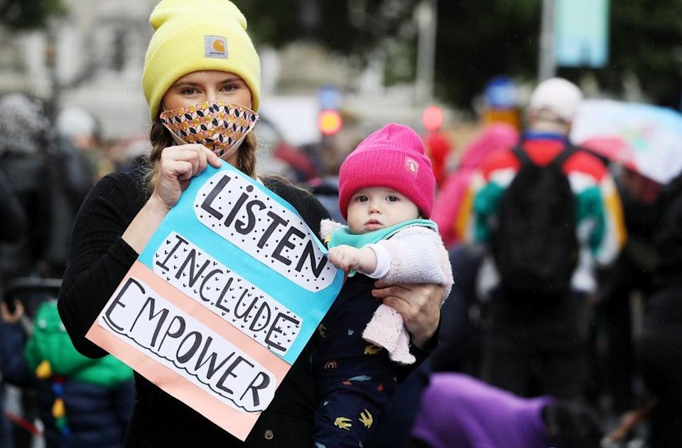 Aoife Kilkenny (left) and her 8 month old son Iarlaith O'Frighil attending a march at Leinster House, Dublin. (Brian Lawless/PA) (PA Wire)