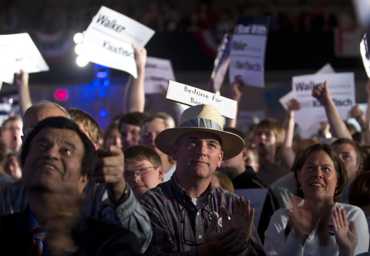 Supporters watch results at the election night rally for Wisconsin Republican Gov. Scott Walker Tuesday, June 5, 2012, in Waukesha, Wis. Walker is running against Democratic challenger Tom Barrett in a special recall election. (AP Photo/Morry Gash)