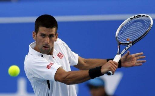 Novak Djokovic returns the ball to Spain's David Ferrer in Abu Dhabi on December 28, 2012