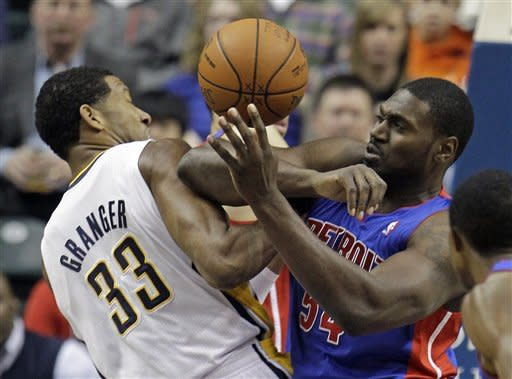 Indiana Pacers' Danny Granger, left, and Detroit Pistons' Jason Maxiell battle for a rebound during the first half of an NBA basketball game Monday, Dec. 26, 2011, in Indianapolis. (AP Photo/Darron Cummings)