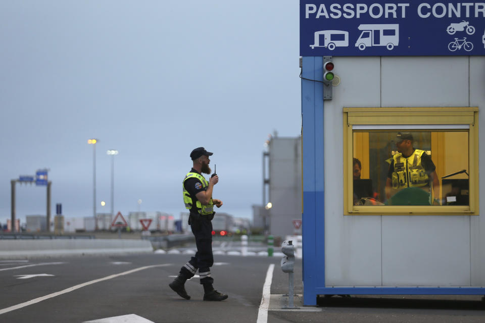 French custom officers work at the transit zone at the port of Ouistreham, Normandy, Thursday, Sept.12, 2019. France has trained 600 new customs officers and built extra parking lots arounds its ports to hold vehicles that will have to go through extra checks if there is no agreement ahead of Britain's exit from the EU, currently scheduled on Oct. 31. (AP Photo/David Vincent)