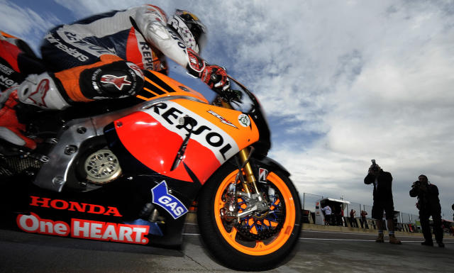 Repsol Honda team's Italian Andrea Dovizioso enters the pit during the Moto GP Training session of the Valencia Grand Prix at Ricardo Tormo racetrack in Cheste, on November 04, 2011. AFP PHOTO / JOSE JORDAN (Photo credit should read JOSE JORDAN/AFP/Getty Images)