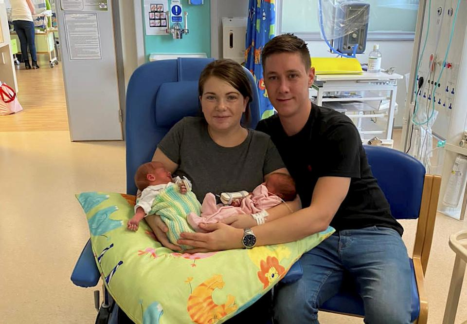 Lorna Whiston with new born twins Reuben and Arya and partner Jonny Parkes. (SWNS)