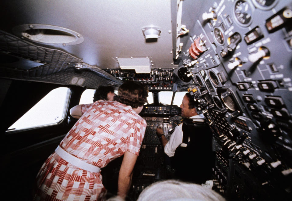 Queen Elizabeth II visiting the flight deck during her flight home from Bridgetown, Barbados, in the supersonic Concorde after her Silver Jubilee tour of Canada and the West Indies.