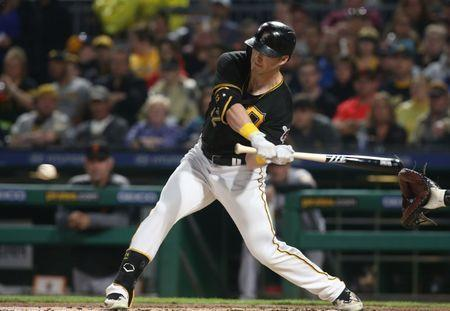 May 12, 2018; Pittsburgh, PA, USA; Pittsburgh Pirates left fielder Corey Dickerson (12) hits an RBI single against the San Francisco Giants during the first inning at PNC Park. Mandatory Credit: Charles LeClaire-USA TODAY Sports