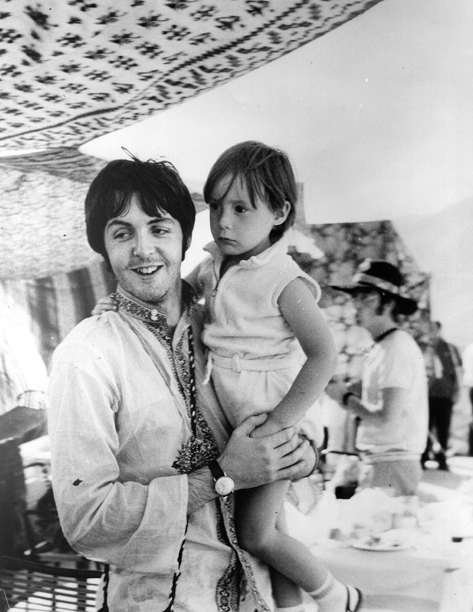<p>Paul McCartney hangs out with his bandmate's four-year-old son while the band was on a break from tour in Greece. A few years later in 1969, Julian's father, John Lennon, would marry Yoko Ono. </p>