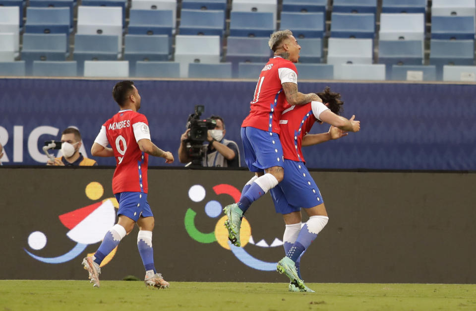 Chile's Ben Brereton, right, celebrates with teammates after scoring his side's opening goal against Bolivia during a Copa America soccer match at Arena Pantanal stadium in Cuiaba, Brazil, Friday, June 18, 2021. (AP Photo/Andre Penner)