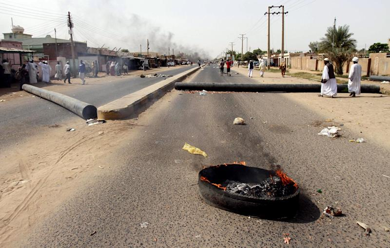 Protesters burn tires and close the highway to northern cities amid a wave of unrest over the lifting of fuel subsidies by the Sudanese government, in Kadro, 15 miles (24.14 kilometers) north of downtown Khartoum, Wednesday, Sept. 25, 2013. Sudan's loss of its main oil-producing territory with the independence of South Sudan in 2011 was a punch to its fragile economy. (AP Photo/Abd Raouf)
