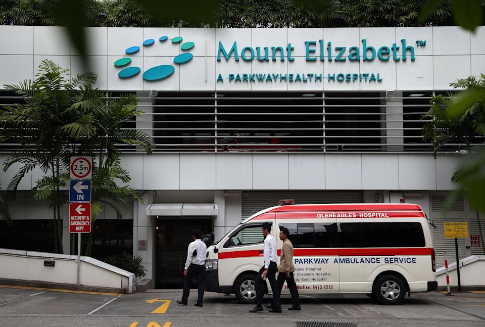 An ambulance is parked outside the Mount Elizabeth Hospital in Singapore Thursday, Dec. 27, 2012. A young woman who was gang-raped and assaulted on a moving bus in the Indian capital was flown Thursday to the Singapore hospital for treatment of severe internal injuries that could last several weeks, officials said. (AP Photo/Wong Maye-E)