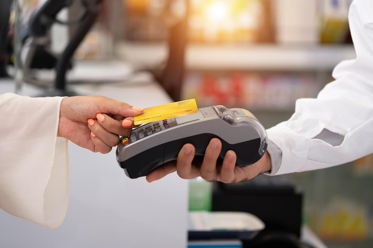 credit card payment service. Customer paying for order of cheese in grocery shop.Credit card payment service The customer pays to order cheese in the pharmacy.