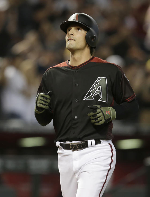 Arizona Diamondbacks' John Ryan Murphy reacts after hitting a solo home run against the Cincinnati Reds in the fourth inning during a baseball game, Monday, May 28, 2018, in Phoenix. (AP Photo/Rick Scuteri)