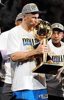 Jason Kidd kisses the Larry O'Brien Trophy after he and the Mavs won their first title