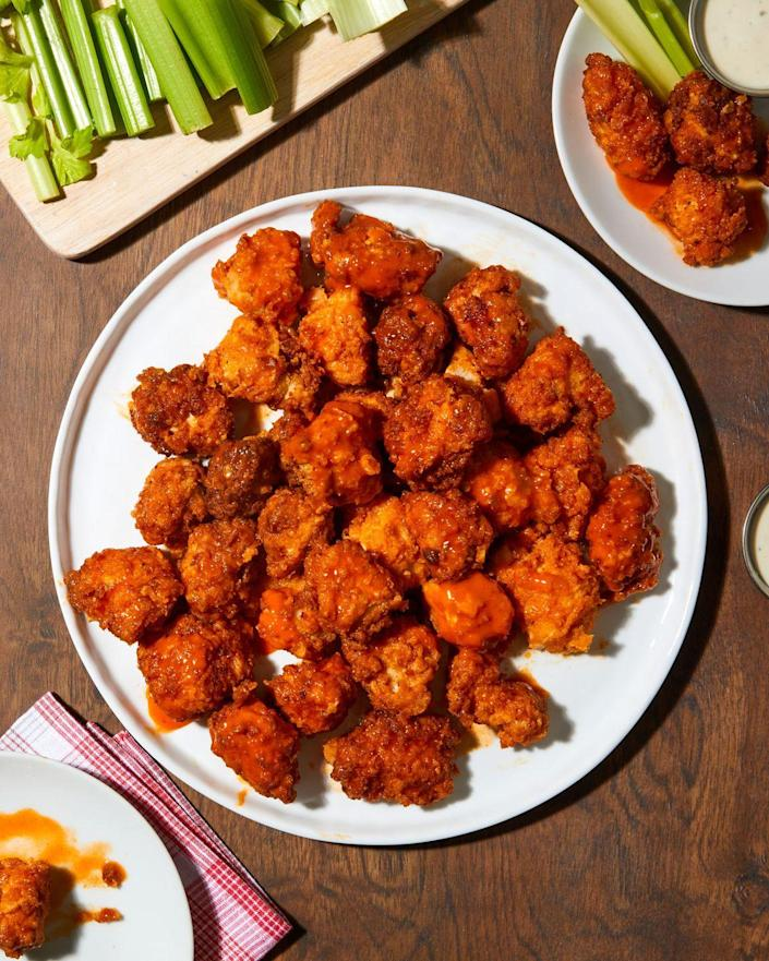 """<p>Fried popcorn chicken is coated in buffalo sauce for a crunchy, spicy, irresistible bite. </p>Get the recipe from <a href=""""https://www.delish.com/cooking/recipe-ideas/a35397804/buffalo-popcorn-chicken-recipe/"""" rel=""""nofollow noopener"""" target=""""_blank"""" data-ylk=""""slk:Delish"""" class=""""link rapid-noclick-resp"""">Delish</a>."""