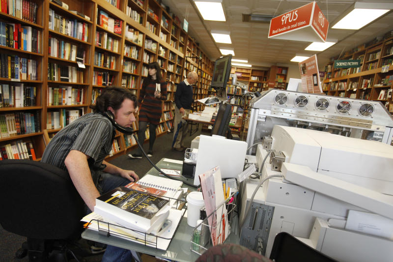 In this June 5, 2012, photo, Bill Leggett works on the Espresso Book Machine, known as Opus, at Politics and Prose bookstore in Washington. Self-publishing has been made easier since the macine by On Demand Books debuted in 2006. The machine also can makes copies of out-of-print editions. The first machine was installed briefly at the World Bank's bookstore. Through a partnership with Xerox, the company now has machines in about 70 bookstores and libraries across the world including London; Tokyo; Amsterdam; Abu Dhabi, United Arab Emirates; Melbourne, Australia; and Alexandria, Egypt. (AP Photo/Jacquelyn Martin)