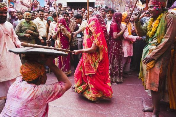 Men bashing <br><br>During Holi, thousands of villagers gather in towns near Mathura in UP to participate in the festival of lathe maar, in which women of the village 'beat up' the Gopis who come to tease them from neighboring villages. With large sticks as their weapon, they attack the men who try to save themselves under a shield.
