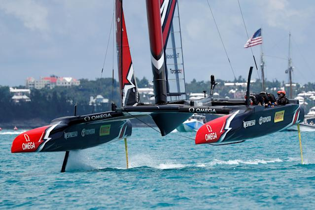 Sailing - America's Cup finals - Hamilton, Bermuda - June 26, 2017 - Peter Burling, Emirates Team New Zealand Helmsman takes his team and boat to the finish line to defeat Oracle Team USA in race nine to win the America's Cup. REUTERS/Mike Segar