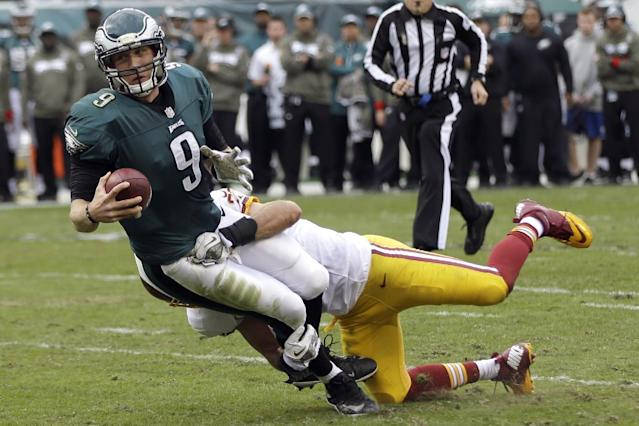 Philadelphia Eagles quarterback Nick Foles (9) is sacked by Washington Redskins strong safety Reed Doughty during the first half of an NFL football game in Philadelphia, Sunday, Nov. 17, 2013. (AP Photo/Matt Rourke)