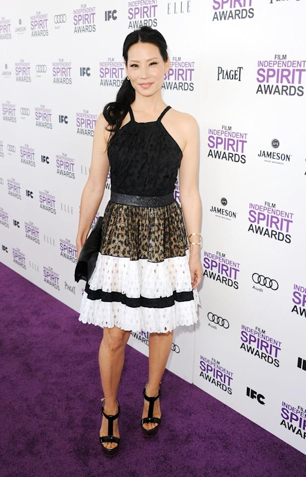 """""""Southland's"""" newest cast member, Lucy Liu, also turned heads upon arriving at the show. The 43-year-old perfectly paired her Roberto Cavalli dress with Guiseppe Zanotti shoes, a Roger Vivier bag, and Piaget baubles."""