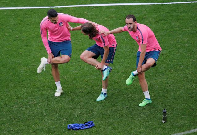 Soccer Football - Europa League Final - Atletico Madrid Training - Groupama Stadium, Lyon, France - May 15, 2018 (L - R) Atletico Madrid's Vitolo, Filipe Luis and Diego Godin during training REUTERS/Vincent Kessler