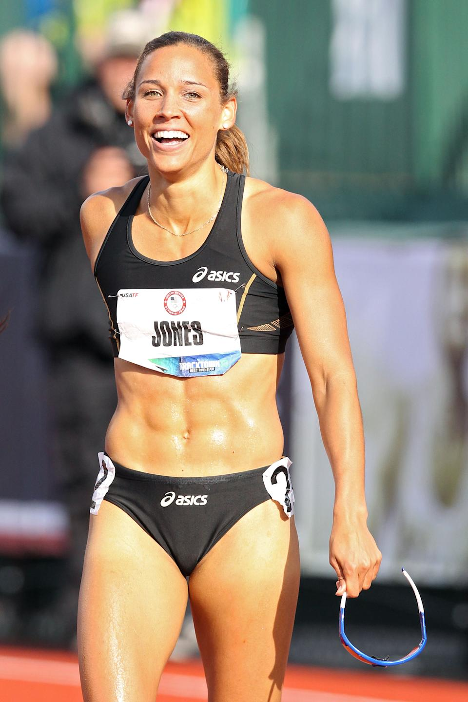 EUGENE, OR - JUNE 23: Lolo Jones reacts after qualifying for 2012 Olympics after coming in third in the women's 100 meter hurdles final during Day Two of the 2012 U.S. Olympic Track & Field Team Trials at Hayward Field on June 23, 2012 in Eugene, Oregon. (Photo by Christian Petersen/Getty Images)