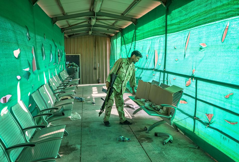 An Afghan army soldier surveys belongings left by the US military inside the Bagram Air Base, some 50 kilometers north of the capital Kabul, Afghanistan, 05 July 2021. (EPA)