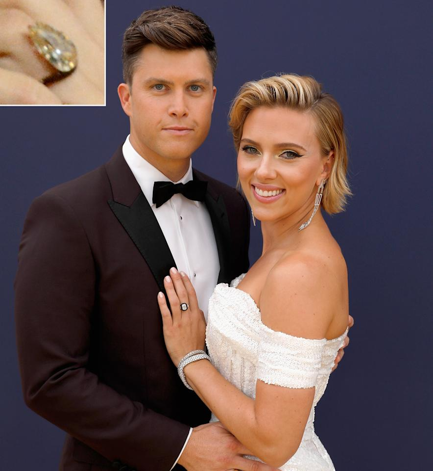 "<em>SNL</em> writer Colin may be a funny guy, but he picked out a <em>serious </em>ring for his movie star fiancée, <a href=""https://people.com/style/scarlett-johansson-debuts-engagement-ring-at-comic-con/"">which she debuted at Comic-Con</a>. The ring is reportedly <a href=""https://www.instagram.com/p/BzSQS2xgmD_/?utm_source=ig_embed"">this one</a> by Taffin de Givenchy, which features an 11-carat pear-shaped brown diamond on a curved band."