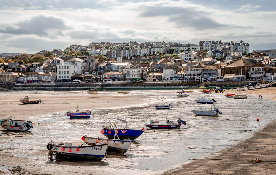 St Ives / UΚ - April 19 2014: Low tide at the beach. St Ives is a seaside town in Cornwall, England and a very popular tourist destination.
