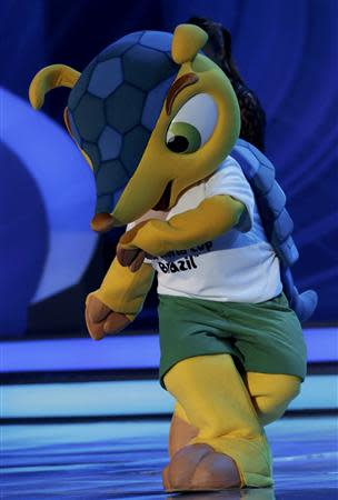 World Cup mascot Fuleco dances on stage during the draw for the 2014 World Cup at the Costa do Sauipe resort in Sao Joao da Mata, Bahia state, December 6, 2013. REUTERS/Ricardo Moraes
