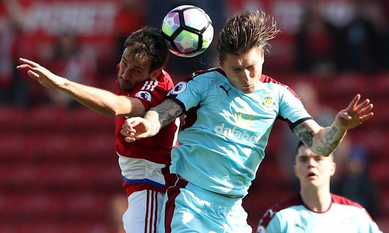 Middlesbrough's Cristhian Stuani contests the ball with Burnley's Jeff Hendrick.
