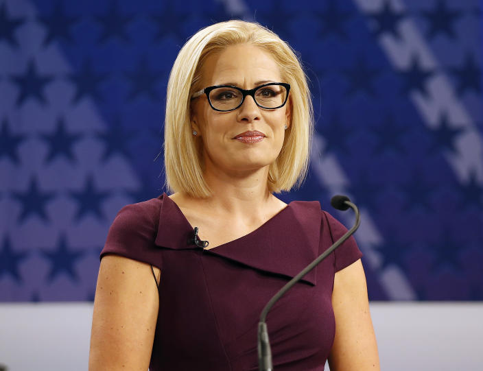 Rep. Kyrsten Sinema, D-Ariz., goes over the rules prior to a televised debate with Rep. Martha McSally, R-Ariz., on Oct. 15, 2018, in Phoenix. (Photo: Matt York/AP)