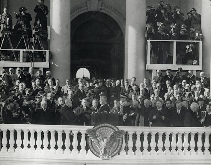 """<span class=""""caption"""">Franklin Delano Roosevelt, standing at center and facing left just above the eagle, takes the presidential oath of office for the third time in 1941.</span> <span class=""""attribution""""><a class=""""link rapid-noclick-resp"""" href=""""https://flickr.com/photos/54078784@N08/6351043453"""" rel=""""nofollow noopener"""" target=""""_blank"""" data-ylk=""""slk:FDR Presidential Library and Museum via Flickr"""">FDR Presidential Library and Museum via Flickr</a>, <a class=""""link rapid-noclick-resp"""" href=""""http://creativecommons.org/licenses/by/4.0/"""" rel=""""nofollow noopener"""" target=""""_blank"""" data-ylk=""""slk:CC BY"""">CC BY</a></span>"""
