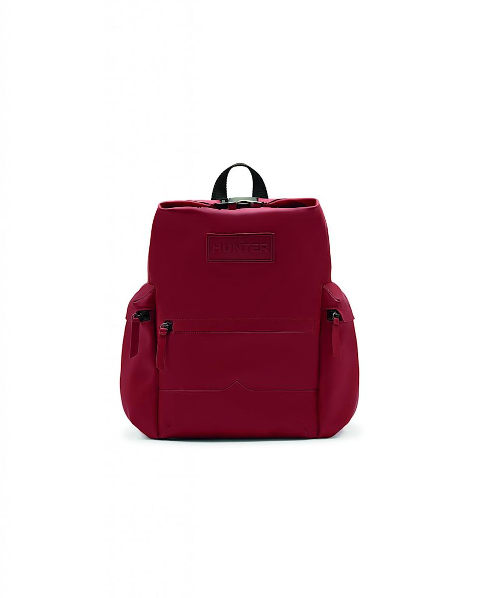"""<p>Hunter Boots original top clip rubberized leather backpack in military red, $295. Available on <a href=""""http://us.hunterboots.com/bags/original-rubberized-leather-backpack/red/2357"""" rel=""""nofollow noopener"""" target=""""_blank"""" data-ylk=""""slk:us.hunterboots.com"""" class=""""link rapid-noclick-resp"""">us.hunterboots.com </a> </p>"""