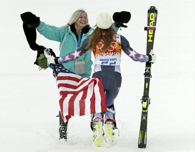 United States' Julia Mancuso celebrates her bronze medal win in the women's supercombined with her sister, Sara, at the Sochi 2014 Winter Olympics, Monday, Feb. 10, 2014, in Krasnaya Polyana, Russia. (AP Photo/Charles Krupa)