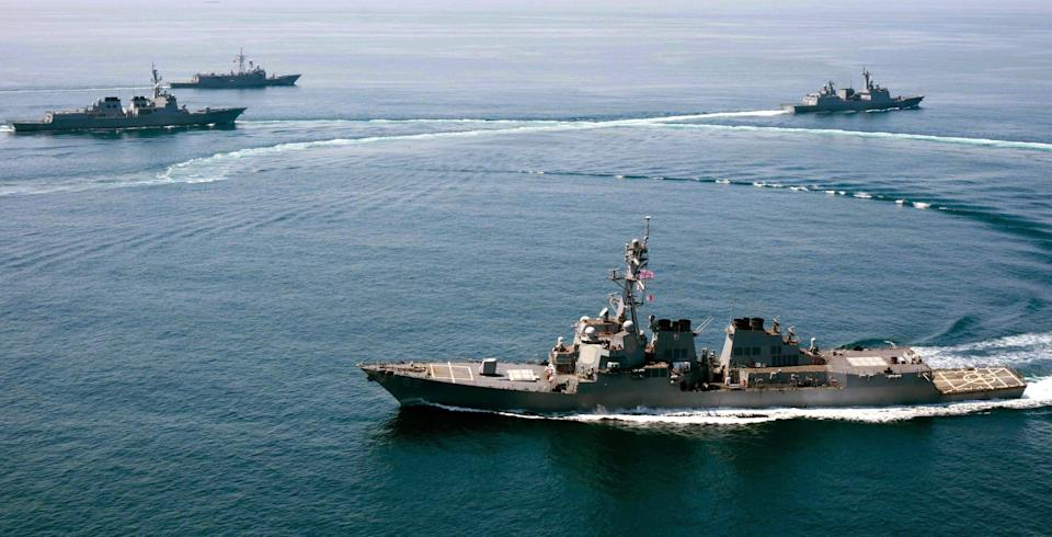 US Navy vessels shown sailing within 12 nautical miles of Subi Reef in the Spratly archipelago in 2015. Source: AAP