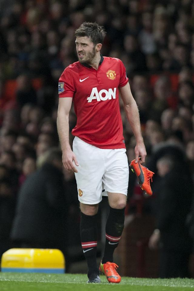 Manchester United's Michael Carrick walks from the pitch after being injured during his team's English League Cup semifinal second leg soccer match against Sunderland at Old Trafford Stadium, Manchester, England, Wednesday Jan. 22, 2014. (AP Photo/Jon Super)