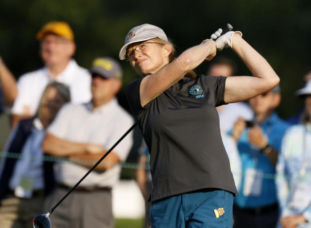 Cindy McConnell tees off on the first hole during the first round of the inaugural U.S. Senior Women's Open golf tournament in Wheaton, Ill., Thursday, July 12, 2018. (Daniel White/Daily Herald via AP)