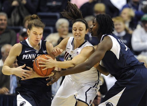 Connecticut's Kelly Faris, center, steals the ball from Penn State's Nikki Greene, right as Greene attempts to pass to Penn State's Maggie Lucas, left, during the first half of an NCAA college basketball game in Storrs, Conn., Thursday, Dec. 6, 2012. (AP Photo/Jessica Hill)