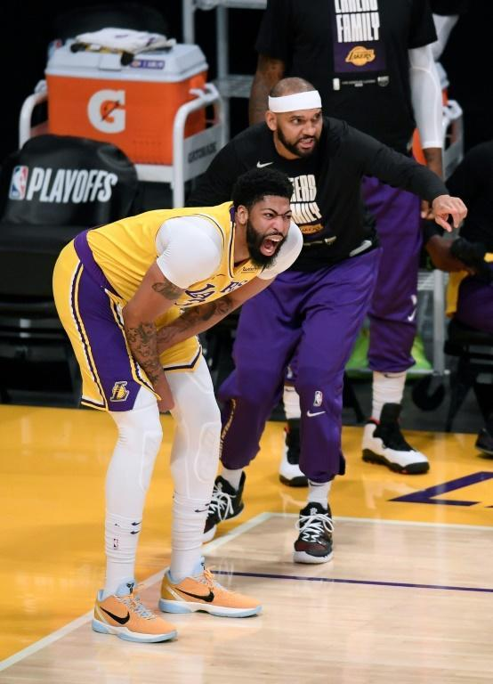 Los Angeles forward Anthony Davis grimaces next to Jared Dudley before departing in the first quarter of the Lakers' game-six loss to the Phoenix Suns that eliminated the NBA champion Lakers from the first round of the playoffs