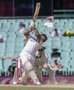 India's Rishabh Pant hits a six during play on the final day of the third cricket test between India and Australia at the Sydney Cricket Ground, Sydney, Australia, Monday, Jan. 11, 2021. (AP Photo/Rick Rycroft)