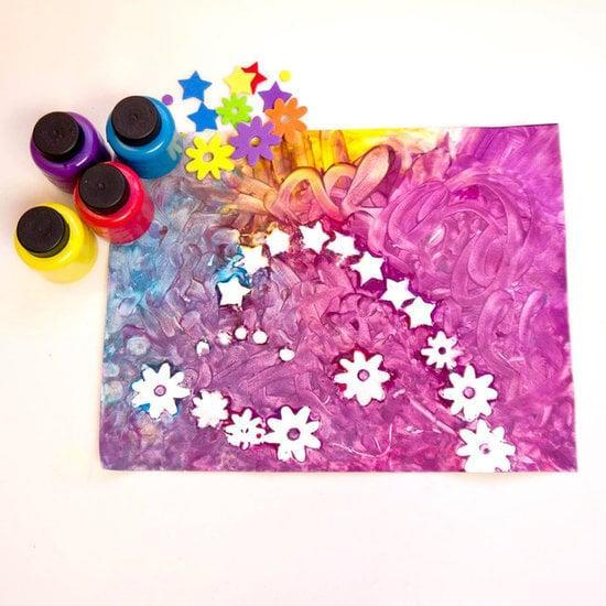 "<p>Finger painting is tons of fun for lil ones, so take things to the next level <a href=""https://www.popsugar.com/family/Finger-Painting-Crafts-Toddlers-24661923"" class=""link rapid-noclick-resp"" rel=""nofollow noopener"" target=""_blank"" data-ylk=""slk:with the help of a few puffy stickers"">with the help of a few puffy stickers</a>.</p>"