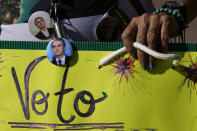 A supporter of Brazil's President Jair Bolsonaro joins a pro-Bolsonaro rally at the Esplanade of Ministries, in Brasilia, Brazil, Sunday, Aug. 1, 2021. Political backers of President Bolsonaro have called for nationwide rallies to express their support for the embattled leader and his call for adding printouts to the electronic voting system. (AP Photo/Eraldo Peres)