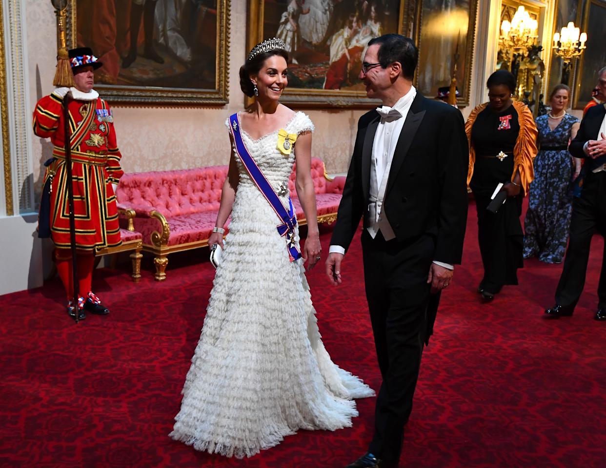 For the US state banquet, the Duchess wore a ruffled white gown by Alexander McQueen with Princess Diana's Lover's Knot tiara and the Queen Mother's sapphire and diamond fringe earrings. Kate also sported her Royal Family Order and debuted her Royal Victorian Order for the first time. [Photo: PA]