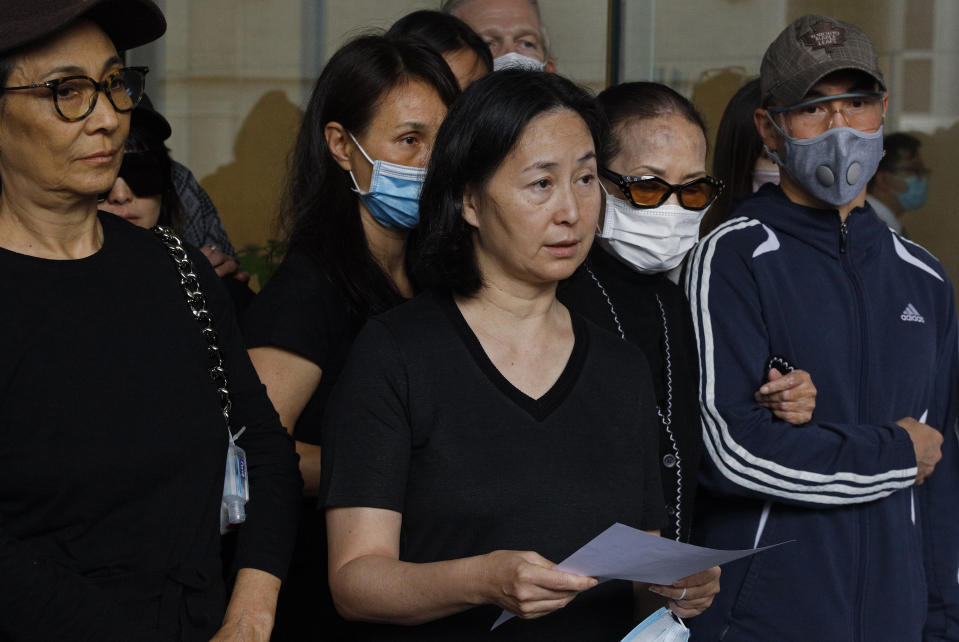Pansy Ho, center, daughter of Macau tycoon Stanley Ho speaks to the press with Ho's family members outside a hospital, Hong Kong, Tuesday, May 26, 2020. Stanley Ho, the dashing billionaire and bon vivant who was considered the father of modern gambling in China, has died, his daughter Pansy Ho said Tuesday. He was 98. (AP Photo/Kin Cheung)