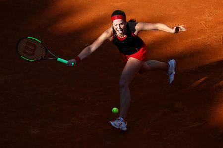 FILE PHOTO: Tennis - WTA Premier 5 - Italian Open - Foro Italico, Rome, Italy - May 18, 2018 Latvia's Jelena Ostapenko in action during her quarter final match against Russia's Maria Sharapova REUTERS/Alessandro Bianchi