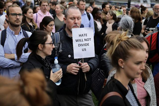 <p>People attend a vigil to remember the victims of the attack on London Bridge and Borough Market which left 7 people dead and dozens injured in central London, Britain June 5, 2017. (Photo: Kevin Coombs/Reuters) </p>