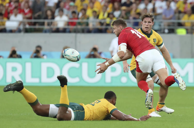 Wales Dan Biggar passes the ball during the Rugby World Cup Pool D game at Tokyo Stadium between Australia and Wales in Tokyo, Japan, Sunday, Sept. 29, 2019. (AP Photo/Eugene Hoshiko)