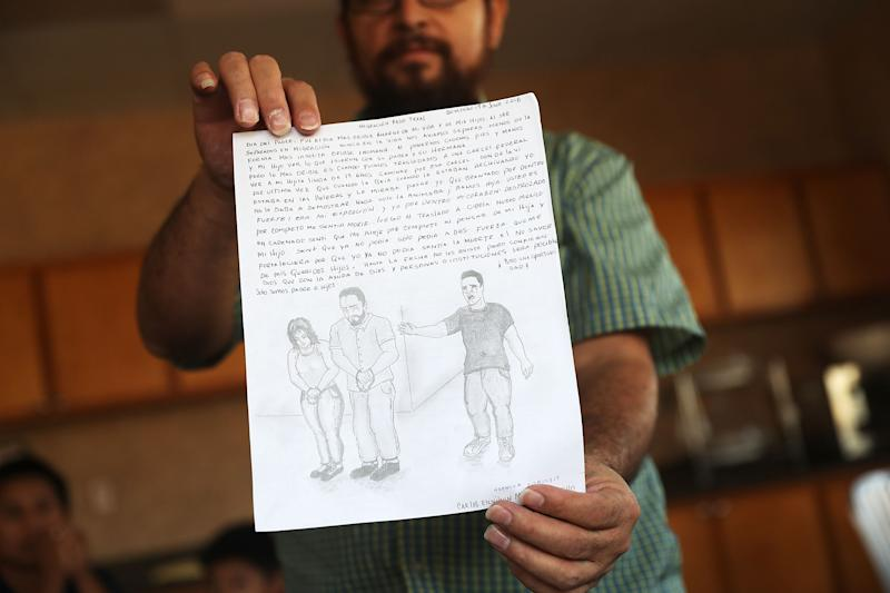 A man identified only as Carlos shows off a drawing he made when his son, Esli (depicted in the right of the drawing) was taken from him on July 25, 2018, in El Paso, Texas