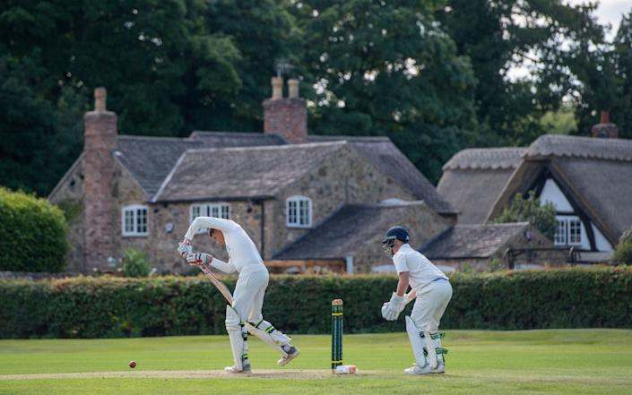 Players in action during an inter-club match at Newtown Linford Cricket Club in Leicestershire - PA
